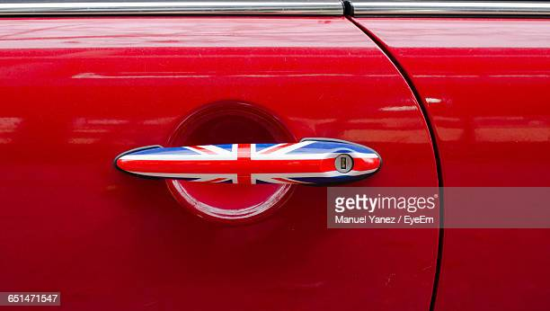 close-up of british flag on car door handle - handle stock pictures, royalty-free photos & images