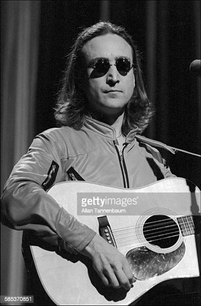 Closeup of British musician John Lennon as he plays guitar onstage at the Hilton Hotel's Grand Ballroom New York New York April 18 1975 The...