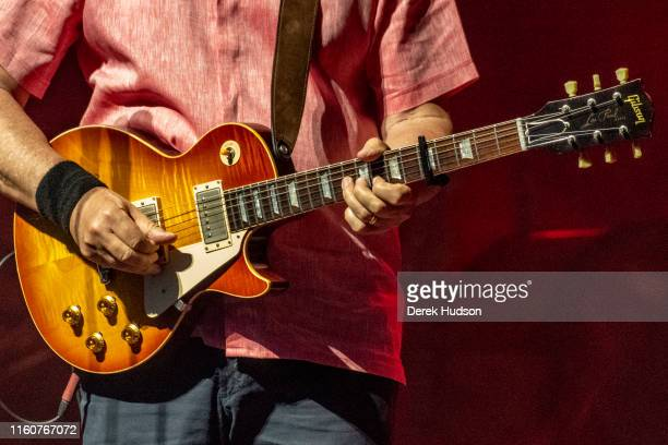 Closeup of British musician Mark Knopfler OBE as he plays guitar on stage at Arena Leipzig Leipzig Germany July 5 2019