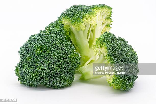 Close-Up Of Broccoli Against White Background