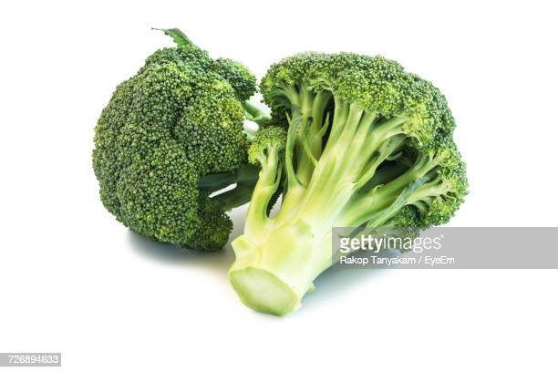Close-Up Of Broccoli Over White Background