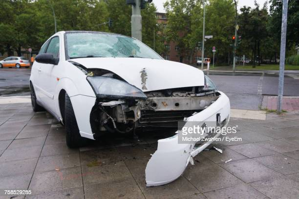 Close-Up Of Broken Car On Road