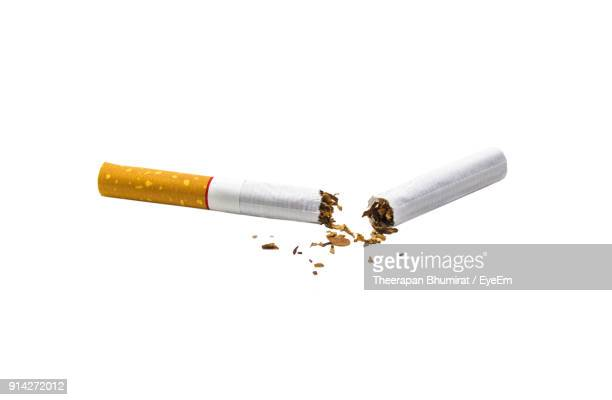 close-up of broken cigarette against white background - cigarette stock pictures, royalty-free photos & images