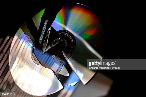 Close-Up Of Broken Compact Disc On Table