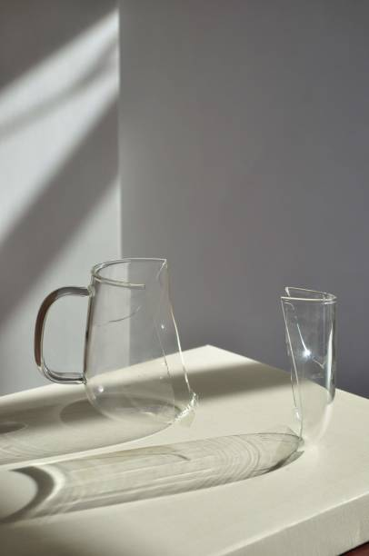 Close-Up Of Broken Drinking Glass On Table