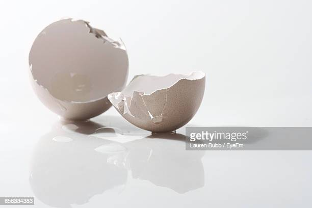 close-up of broken eggshell on white background - eggshell stock pictures, royalty-free photos & images