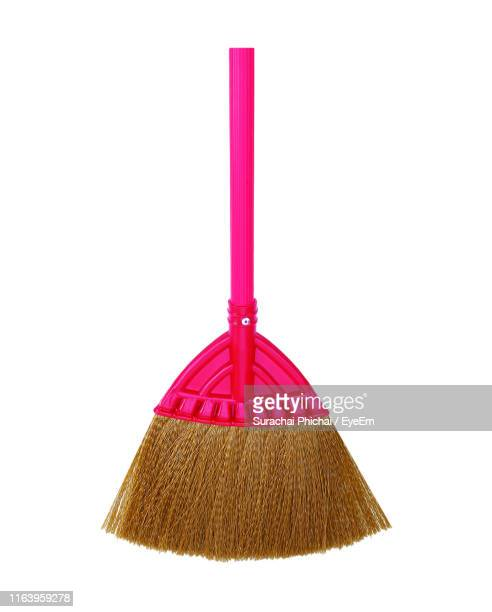 close-up of broom against white background - broom stock pictures, royalty-free photos & images