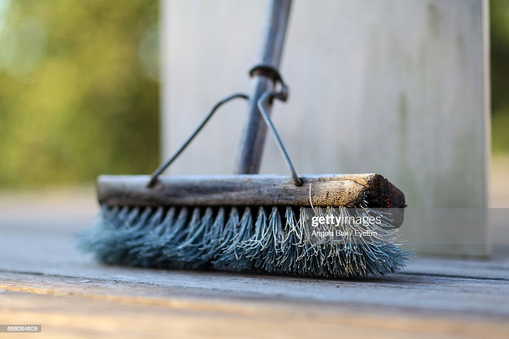 Close-Up Of Broom On Footpath : Stock Photo