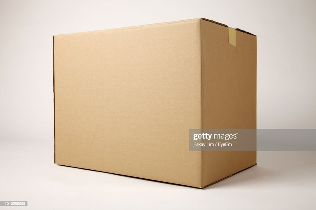 Close-Up Of Brown Cardboard Box Against White Background : Stock Photo
