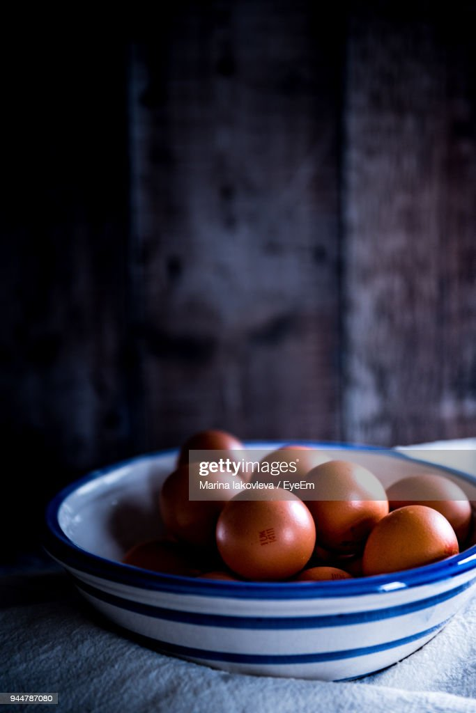 Close-Up Of Brown Eggs In Bowl On Table : Stock Photo