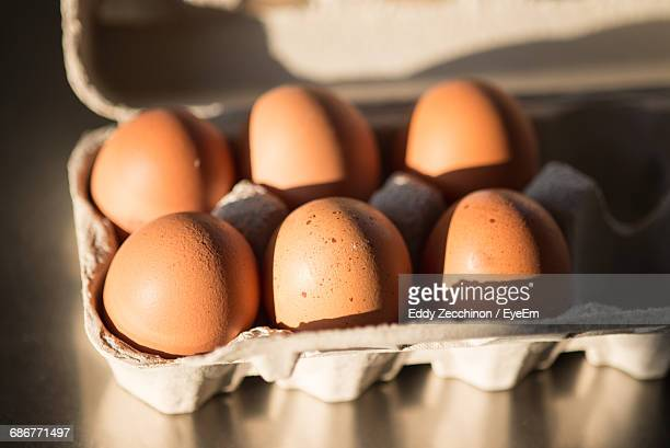 Close-Up Of Brown Eggs In Egg Carton