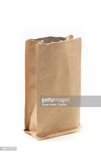 Close-Up Of Brown Paper Bag Against White Background