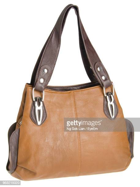 Close-Up Of Brown Purse Against White Background