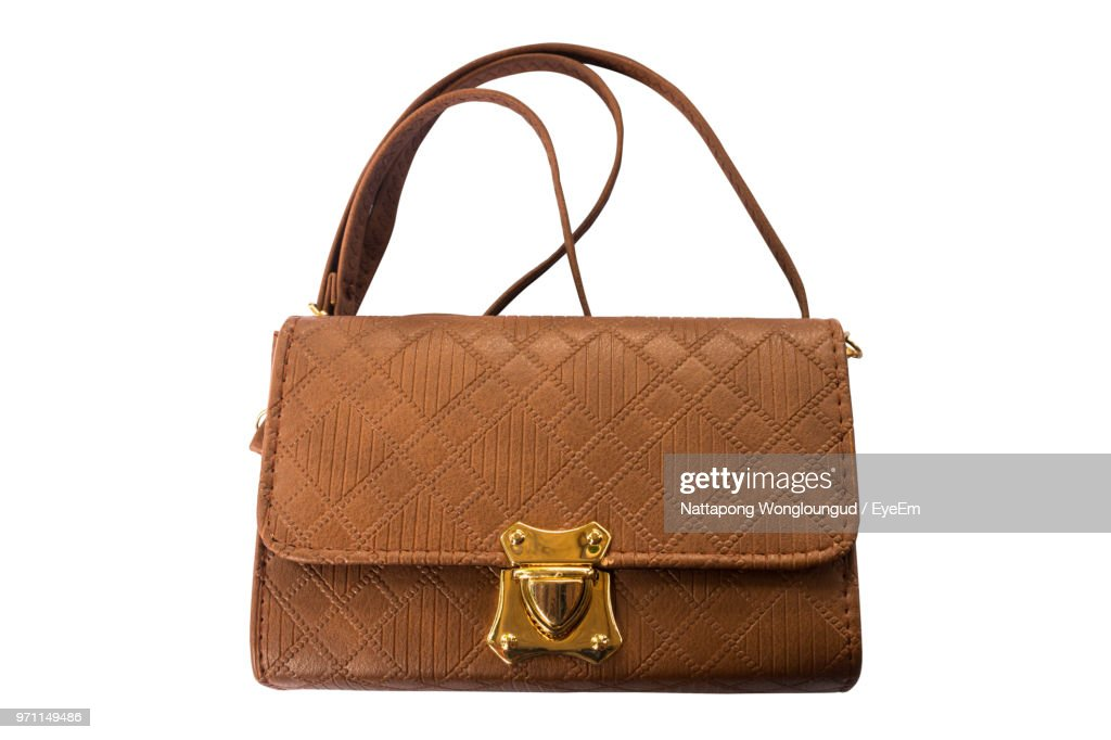 Close-Up Of Brown Purse Over White Background : Stock Photo