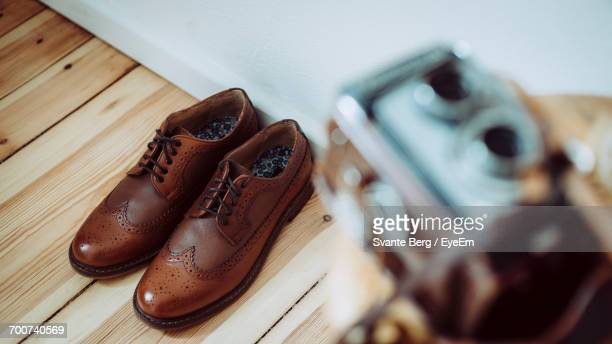 close-up of brown shoes - leather shoe stock pictures, royalty-free photos & images