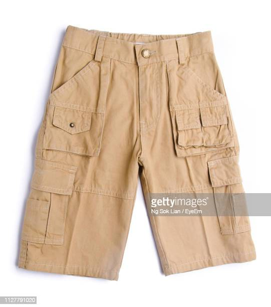 close-up of brown shorts on white background - calção - fotografias e filmes do acervo