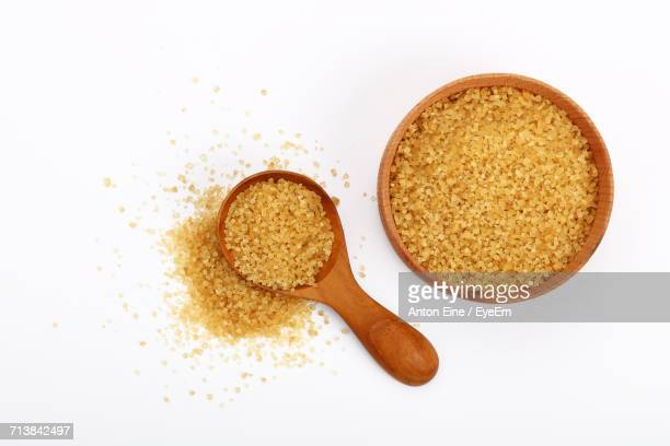 Close-Up Of Brown Sugar Against White Background