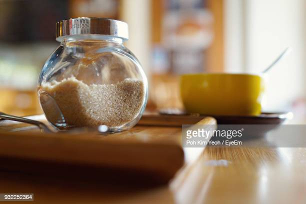 Close-Up Of Brown Sugar In Jar On Table