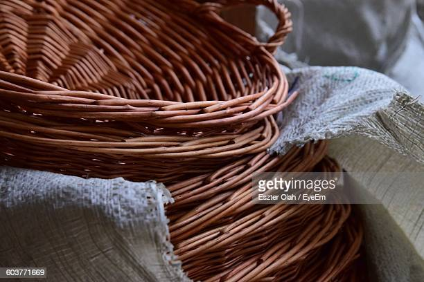 Close-Up Of Brown Wicker Basket Stack In Sack