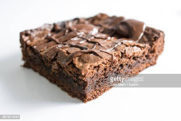 Close-Up Of Brownie Over White Background