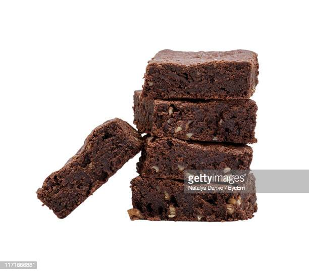 close-up of brownies against white background - brownie stock pictures, royalty-free photos & images