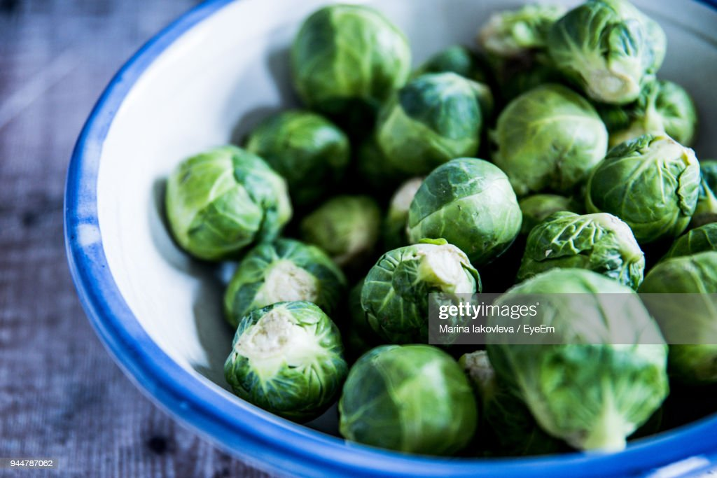 Close-Up Of Brussels Sprouts In Bowl On Table : Stock Photo