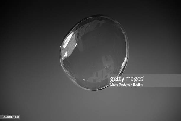 Close-Up Of Bubble Against Gray Background