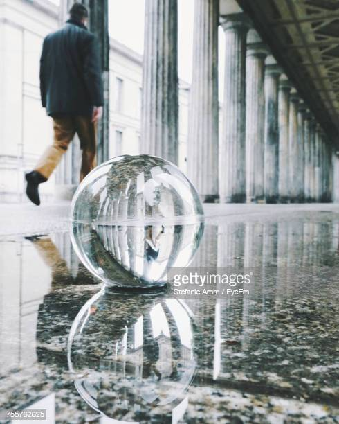 close-up of bubble on floor with man walking in background - people inside bubbles stock pictures, royalty-free photos & images