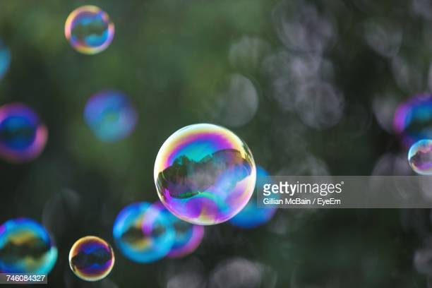 Close-Up Of Bubbles Against Rainbow