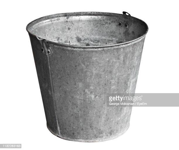close-up of bucket against white background - bucket stock pictures, royalty-free photos & images