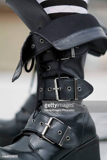 close-up of buckle up leather boots - leather belt stock pictures, royalty-free photos & images
