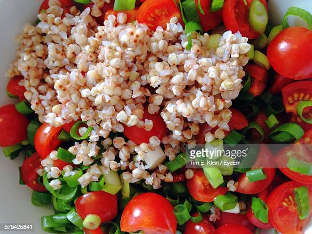 close-up of buckwheat with tomato in bowl - buckwheat stock pictures, royalty-free photos & images