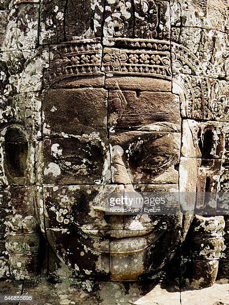 Close-Up Of Buddha Face Carved On Stone At Angkor Wat Temple