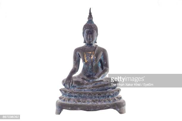 close-up of buddha statue against white background - buddha stock photos and pictures