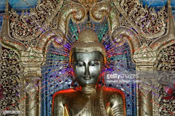 close-up of buddha statue in temple - gerhard schimpf stock pictures, royalty-free photos & images