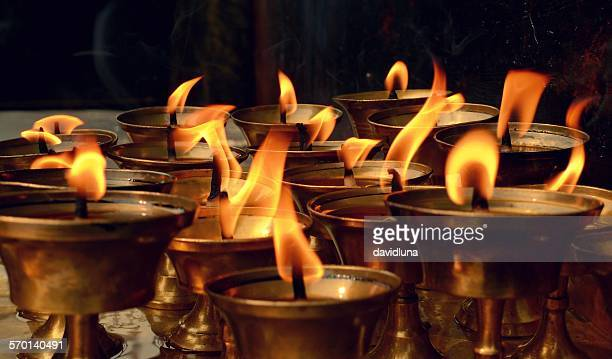 close-up of buddhist candles - eternal flame stock photos and pictures
