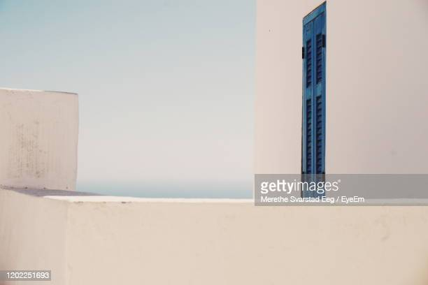 close-up of built structure against clear sky - greece stock pictures, royalty-free photos & images