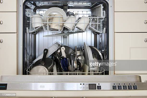 Close-up of built-in dishwasher with cleaned dishes inside, front view
