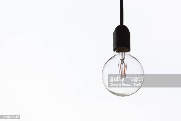 close-up of bulb over white background - light bulb stock pictures, royalty-free photos & images
