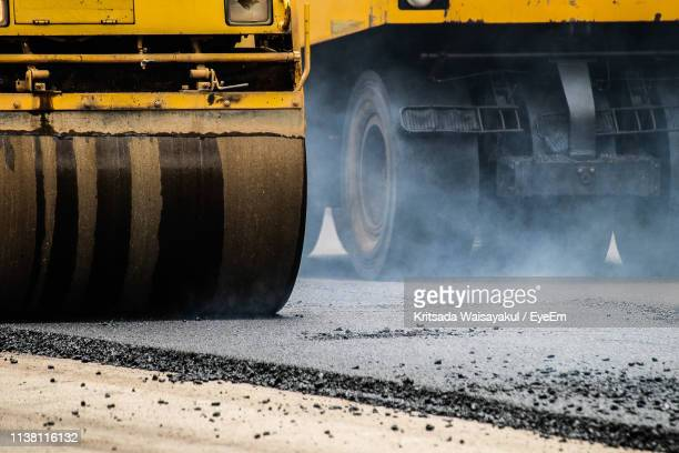 close-up of bulldozer at construction site - road construction stock pictures, royalty-free photos & images