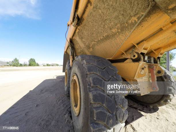 close-up of bulldozer on sand against sky - frank schrader stock pictures, royalty-free photos & images