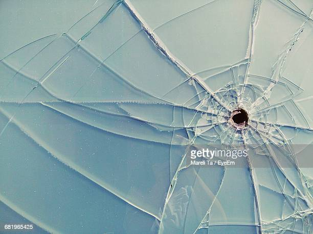Close-Up Of Bullet Hole On Glass Window