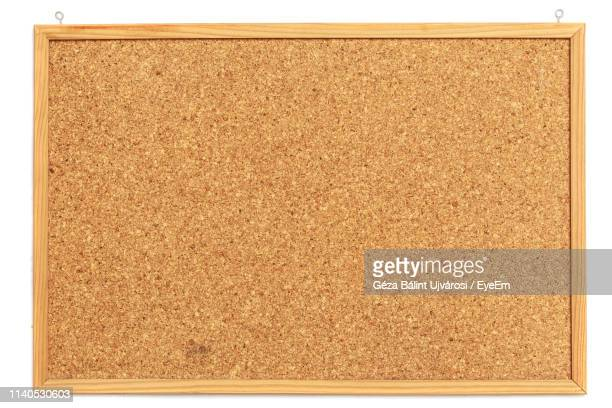 close-up of bulletin board on white background - bulletin board stock pictures, royalty-free photos & images