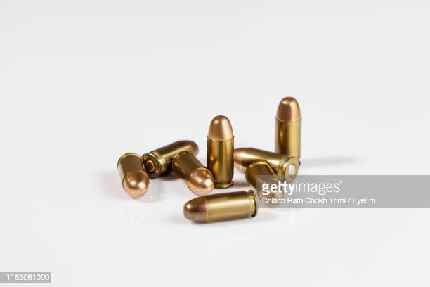 close-up of bullets against white background - bullet stock pictures, royalty-free photos & images