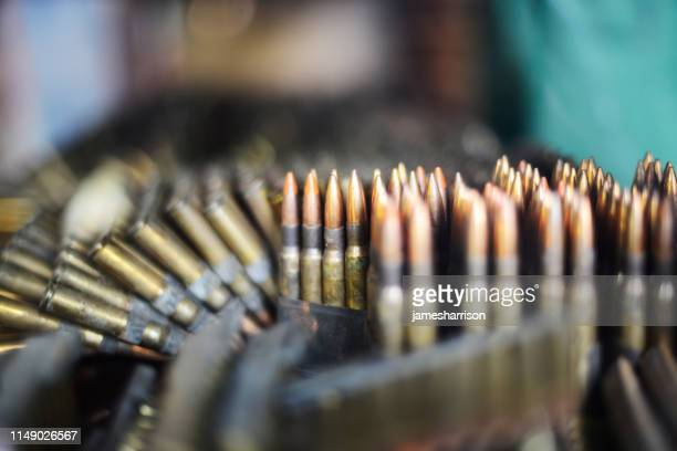 close-up of bullets for an ak-47 - weaponry stock pictures, royalty-free photos & images