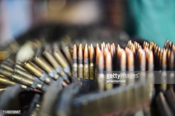 close-up of bullets for an ak-47 - armamento imagens e fotografias de stock