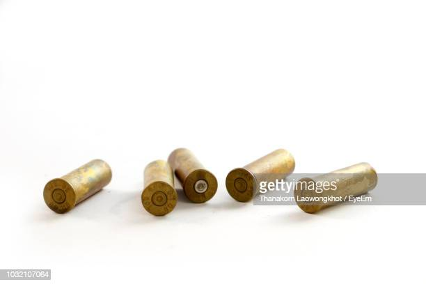 close-up of bullets on white background - bullet stock photos and pictures