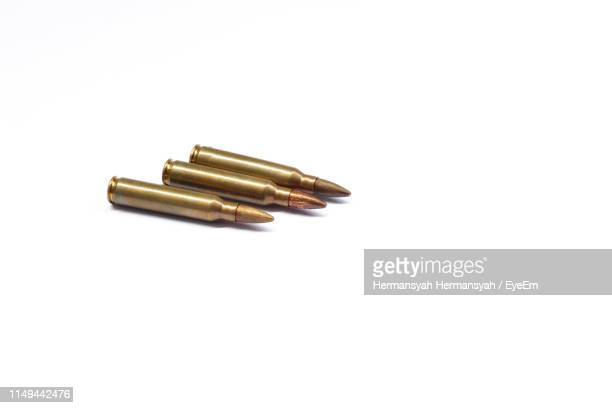 close-up of bullets on white background - bullet stock pictures, royalty-free photos & images
