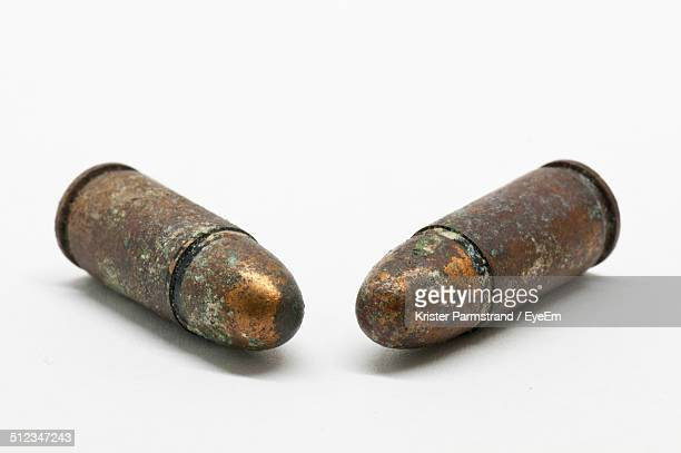 Close-Up of Bullets Over White Background