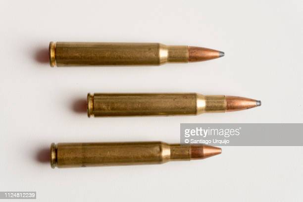 close-up of bullets - weaponry stock pictures, royalty-free photos & images